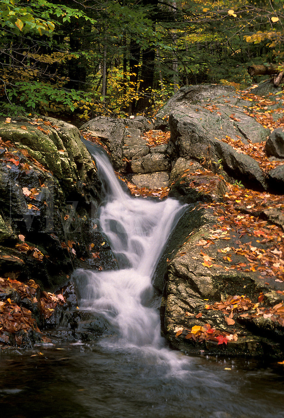 AJ1802, waterfall, fall, river, Maine, White Mountain National Forest, Waterfall flows down over the rocks into the river in the fall.