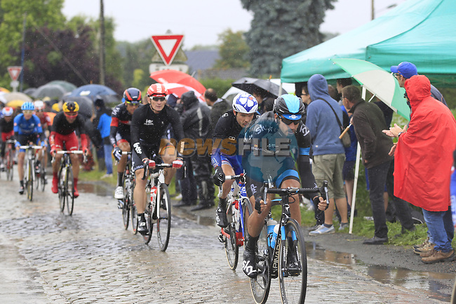 Riders including David Lopez Garcia (ESP) Team Sky and Andre Greipel (GER) Lotto-Belisol tackle the1st cobbled sector 9 from Gruson to Crossroads de l'Arbe during Stage 5 of the 2014 Tour de France running 155.5km from Ypres to Arenberg. 9th July 2014.<br /> Picture: Eoin Clarke www.newsfile.ie