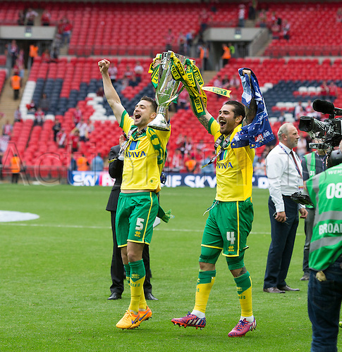 25.05.2015.  London, England. Skybet Championship Playoff Final. Middlesborough versus Norwich. Norwich City's Russell Martin and Bradley Johnson celebrate with the trophy at the final whistle as their side is promoted to the Premier league