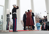 United States President-elect Donald Trump kisses First Lady Michelle Obama as hi and his wife Melania are greeted by President Barack Obama and the First Lady as they arrive at the White House prior to his inauguration in Washington, D.C. on January 20, 2017. Later today Donald Trump will be sworn-in as the 45th President. <br /> Credit: Kevin Dietsch / Pool via CNP
