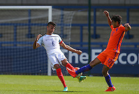 Easah Suliman (Cheltenham Town on loan from Aston Villa) of England U19 & Mitchell Van Rooijen (Jong FC Utrecht) of Holland go for the ball during the International match between England U19 and Netherlands U19 at New Bucks Head, Telford, England on 1 September 2016. Photo by Andy Rowland.