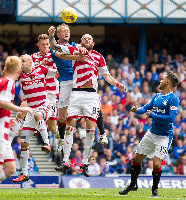 Clint Hill attackig the ball for Rangers