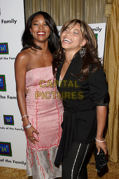 GABRIELLE UNION & TISHA CAMPBELL MARTIN.The 9th Annual Family Matters Benefit and Celebration held at the Regent Beverly Wilshire Hotel, Beverly Hills, Los Angeles, California, USA, 3 June 2005..half length pink dress .Ref: ADM.www.capitalpictures.com.sales@capitalpictures.com.©AdMedia/Capital Pictures.