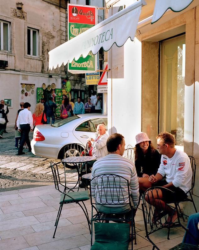 Friends at a cafe in Ostuni, Puglia, Italy