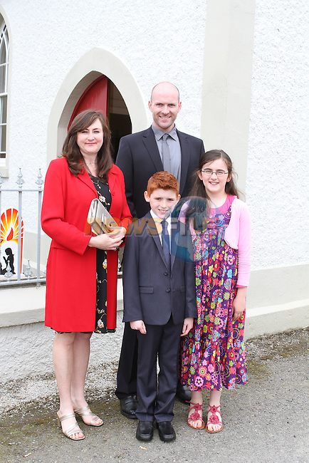 Logan Taaffe with his family at Phillipstown Communion in St.Kevins Church...(Photo Jenny Matthews/www.newsfile.ie)