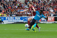 Devante Cole of Fleetwood Town rides the tackle by Ash Taylor of Northampton Town to score the only goal of the match during the Sky Bet League 1 match between Northampton Town and Fleetwood Town at Sixfields Stadium, Northampton, England on 12 August 2017. Photo by Alan  Stanford / PRiME Media Images.