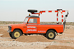 Africa, Morocco, Western Sahara, nr. Dakhla. Land Rover Santana recovery truck. --- No releases available. Automotive trademarks are the property of the trademark holder, authorization may be needed for some uses. --- Info: From the mid 1950's untill the early 1990's the english Land Rover was also built under license in Spain. The spanish company Metalurgica de Santa Ana (later to become Santana Motor SA), was producing Land Rovers in the beginning from CKD kits, but local content was gradually increased until the Santanas (this is how they were called) were 100 per cent locally manufactured.
