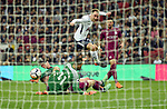 Christian Eriksen of Tottenham Hotspur scores his goal to make it 1-2 past Manchester City goalkeeper Ederson during the premier league match at the Wembley Stadium, London. Picture date 14th April 2018. Picture credit should read: Robin Parker/Sportimage