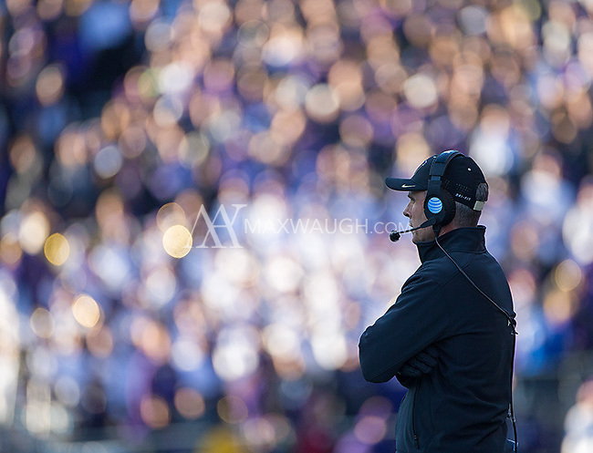 Chris Petersen watches the action unfold.