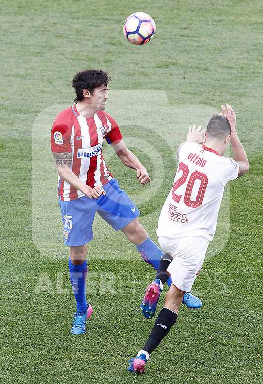 Atletico de Madrid's Stefan Savic (l) and Sevilla FC's Vitolo during La Liga match. March 19,2017. (ALTERPHOTOS/Acero)