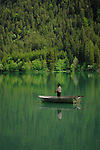 Fishing from a rowing boat in Lake Haldensee, Nesslewangle, Reutte district. Austria.The Alps