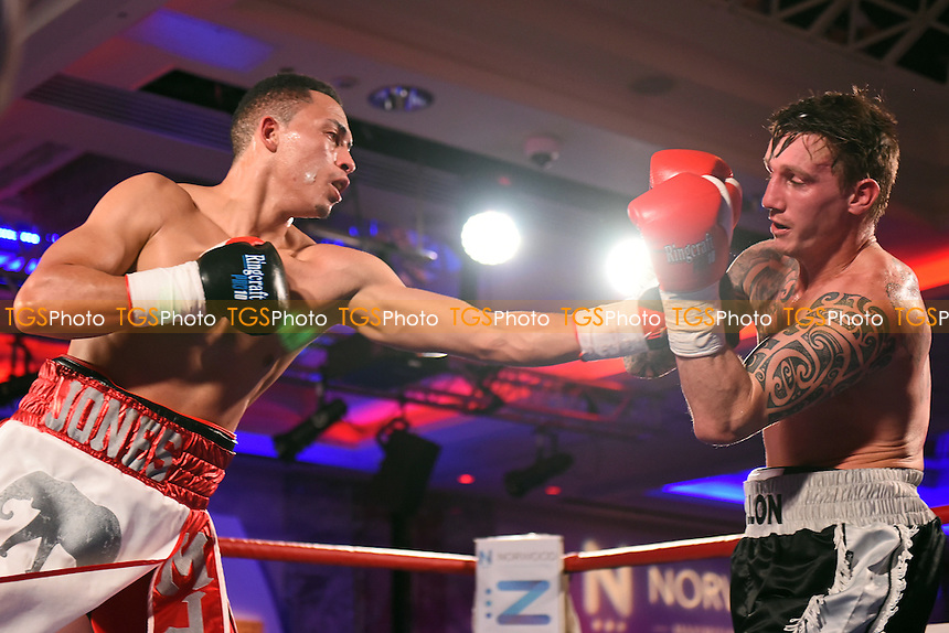 Morgan Jones (white/red shorts) defeats Luke Allon during a Boxing Show at the Royal Lancaster Hotel