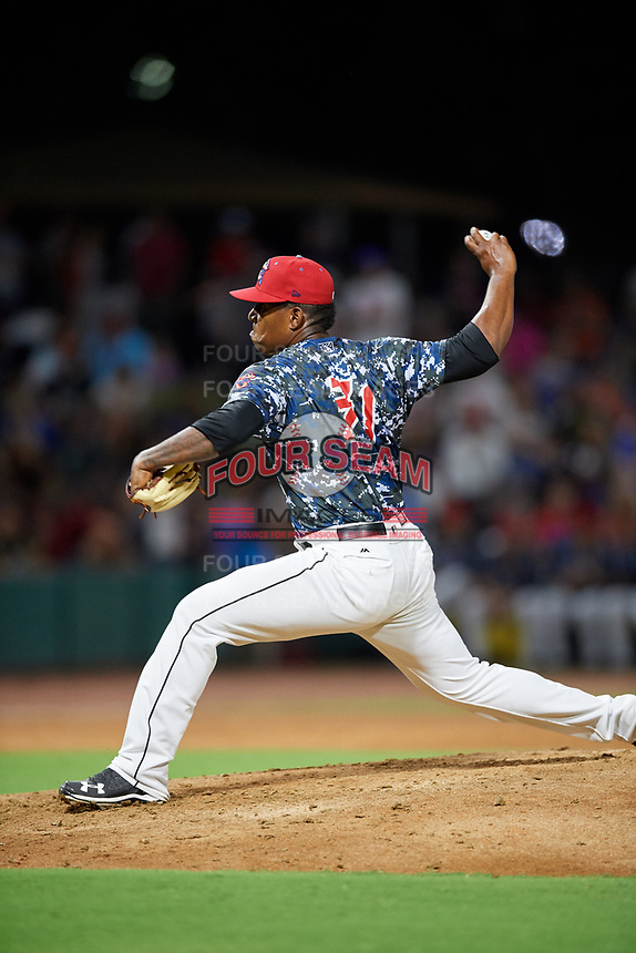 Jacksonville Jumbo Shrimp relief pitcher Esmerling De La Rosa (31) delivers a pitch during a game against the Mobile BayBears on April 14, 2018 at Baseball Grounds of Jacksonville in Jacksonville, Florida.  Mobile defeated Jacksonville 13-3.  (Mike Janes/Four Seam Images)