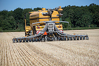 Challenger Rogator applying digestate into rye stubble