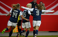 Offenbach, Germany, Friday, April 05 2013: Womans, Germany vs. USA, in the Stadium in Offenbach,   Whitney Engen, Megan Rapinoe, Heather O`Reilly (USA) celebrates the Goal..