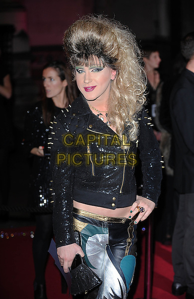 JODIE HARSH.attending The British Fashion Awards, Royal Courts of Justice, London, England, UK, 9th December 2009..arrivals half length jacket clutch bag nail nails polish varnish wig make-up green eyeshadow hair drag queen black leather studs studded .CAP/BEL.©Tom Belcher/Capital Pictures.