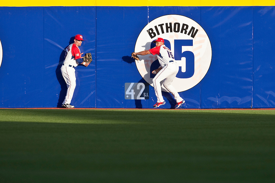 11 March 2009: #15 Carlos Beltran of Puerto Rico goes for the ball at the wall next to #23 Jesus Feliciano during the 2009 World Baseball Classic Pool D game 6 at Hiram Bithorn Stadium in San Juan, Puerto Rico. Puerto Rico wins 5-0 over the Netherlands