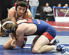 Vito Arujau of Syosset, top, battles Christian Dougherty of MacArthur at 138 pounds during the Nassau County Divsision I varsity wrestling quarterfinals at Hofstra University on Saturday, Feb. 11, 2017. Arujau won the match by fall at 1:32.