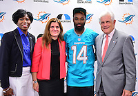 MIAMI, FL - SEPTEMBER 20: BankUnited Vice President of Community Development & Outreach Katrina Wright, Miramar High School Principal Maria Formoso, Miami Dolphins Wide Receiver (#14) Jarvis Landry and BankUnited Senior Executive Vice President Gerry Litrento surprise the Miramar Patriots varsity football team prior to the teamís practice as part of the 4 Downs for Finance financial literacy program sponsored by BankUnited. Landry share his thoughts on the importance of financial literacy at Miramar High School Media Center on September 20, 2016 in Miramar, Florida. Credit: MPI10 / MediaPunch