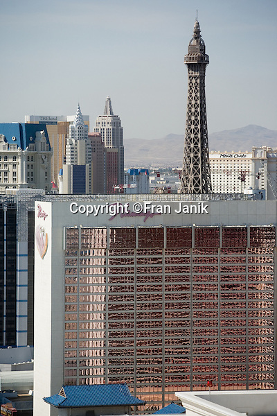 A View of the Flamingo hotel and casino, other hotels including Paris,New York,The Hotel,and The Monte Carlo rise from behind. This shot was taken from the Venetian Hotel looking south on the Las Vegas strip. The desert hills can be seen in the distance.