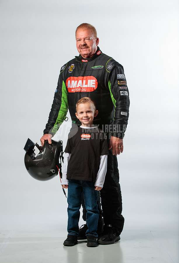 Feb 6, 2019; Pomona, CA, USA; NHRA top fuel driver Terry McMillen poses for a portrait with son Cameron McMillen during NHRA Media Day at the NHRA Museum. Mandatory Credit: Mark J. Rebilas-USA TODAY Sports
