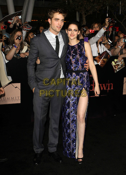 "Robert Pattinson & Kristen Stewart .""The Twilight Saga: Breaking Dawn Part 1"" Los Angeles Premiere Held At The Nokia Theatre L.A. Live, Los Angeles, California, USA, 14th November 2011..full length grey gray suit tie white shirt  hand in pocket blue purple sequined sequin sheer beaded dress peep toe shoes black heels couple arm around thigh leg side split slit .CAP/ADM/KB.©Kevan Brooks/AdMedia/Capital Pictures."