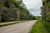 The Hooker Cut on Route 66 in Missouri was built in 1941 to bypass the original narrow cury road.  The construction of Fort Leonard Wood greatly increased the traffic in the area.  In 1941 this section of Route 66 was one of only two 4 lane highways in the United States.  At the time the cut in the rock was 90 feet,making it the deepest road cut in america.