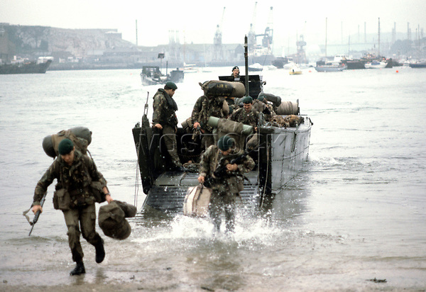 Troops of 29 Commando Royal Artillery disembark from a landing craft at Plymouth on returning from the Falklands conflict aboard HMS Intrepid.<br /> Falklands War - Troops Returning<br /> 1 July 1982