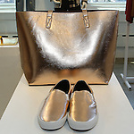 "Metallic footwear and tote from the ""Snowed In"" collection, displayed during the Old Navy Holiday 2015 fashion presentation."