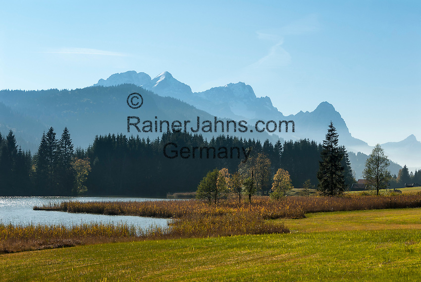 Germany, Bavaria, Upper Bavaria, Werdenfelser Land, Kruen - district Gerold: autumn scenery at hiking region Lake Geroldsee between Mittenwald and Garmisch-Partenkirchen, at background Wetterstein mountains with summits Alpspitze, Zugspitze and Waxenstein | Deutschland, Bayern, Oberbayern, Werdenfelser Land, Kruen - Ortsteil Gerold: Herbststimmung in der Wanderregion am Geroldsee - auch Wagenbruechsee genannt - zwischen Mittenwald und Garmisch-Partenkirchen, im Hintergrund das Wettersteingebirge mit Alpspitze, Zugspitze und Waxenstein