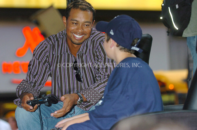 WWW.ACEPIXS.COM . . . . .  ....NEW YORK, SEPTEMBER 26, 2005....Tiger Woods challenges enter-to-win contestants to a round of virtual golf on his new Electronic Arts game 'Tiger Woods PGA Tour '06' in the Virgin Megastore, Times Square games department.....Please byline: AJ Sokalner - ACE PICTURES..... *** ***..Ace Pictures, Inc:  ..Craig Ashby (212) 243-8787..e-mail: picturedesk@acepixs.com..web: http://www.acepixs.com