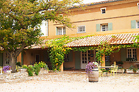 the Domaine de Cabasse hotel and restaurant. Provencal colours, in autumn. The courtyard. Domaine de Cabasse Hotel Restaurant, Alfred and Antoinette Haeni, Séguret, Seguret Cote du Rhone Vaucluse Provence France Europe