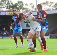 Peterborough United's Jason Cummings shields the ball from Scunthorpe United's Cameron Borthwick-Jackson<br /> <br /> Photographer Chris Vaughan/CameraSport<br /> <br /> The EFL Sky Bet League One - Scunthorpe United v Peterborough United - Saturday 13th October 2018 - Glanford Park - Scunthorpe<br /> <br /> World Copyright &copy; 2018 CameraSport. All rights reserved. 43 Linden Ave. Countesthorpe. Leicester. England. LE8 5PG - Tel: +44 (0) 116 277 4147 - admin@camerasport.com - www.camerasport.com