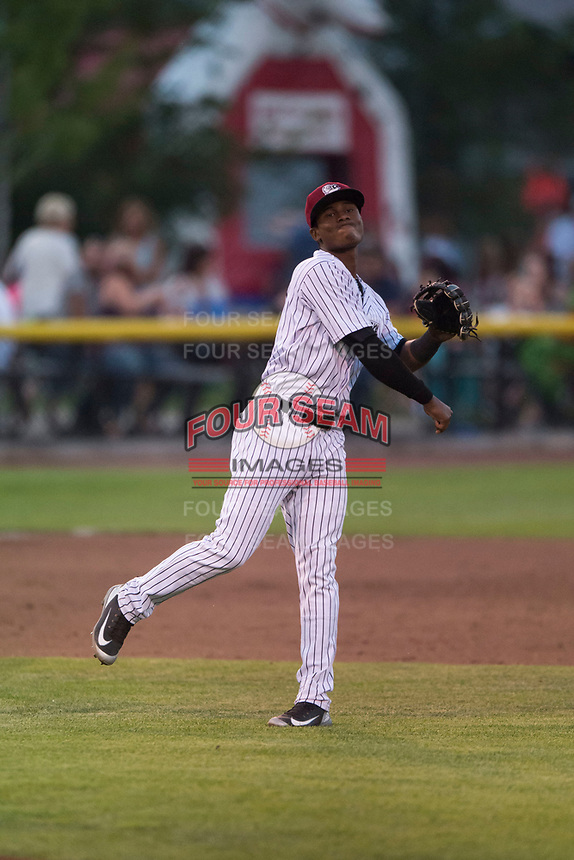 Idaho Falls Chukars third baseman Angel Medina (46) follows through on a throw to first base during a Pioneer League game against the Great Falls Voyagers at Melaleuca Field on August 18, 2018 in Idaho Falls, Idaho. The Idaho Falls Chukars defeated the Great Falls Voyagers by a score of 6-5. (Zachary Lucy/Four Seam Images)
