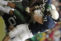 20 November 2004:  PSU's Paul Posluszny (31) hit MSU's Jason Teague (20).  Penn State defeated Michigan State 37-13 November 20, 2004 at Beaver Stadium in State College, PA....