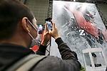 A visitor takes pictures of a huge poster of Mazinger Z on display during the AnimeJapan 2017 at Tokyo Big Sight on March 25, 2017, Tokyo, Japan. AnimeJapan 2017 is a trade show promoting ''Everything Anime'' to local and foreign fans and businesses. The show is held over four-day days with March 23-24 reserved for business visitors and March 25-26 for the public. It is expected to attract some 120,000 visitors, including cosplayers. (Photo by Rodrigo Reyes Marin/AFLO)