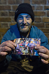 © Joel Goodman - 07973 332324 . Manchester , UK . 05/04/2015 . Homeless Darren Jones shows a folded up photograph of himself with revellers , taken by photographer Joel Goodman , which featured in the news in Christmas 2014 , which he keeps folded up in his pocket . Revellers on a Saturday night out during the Easter Bank Holiday weekend . Photo credit : Joel Goodman