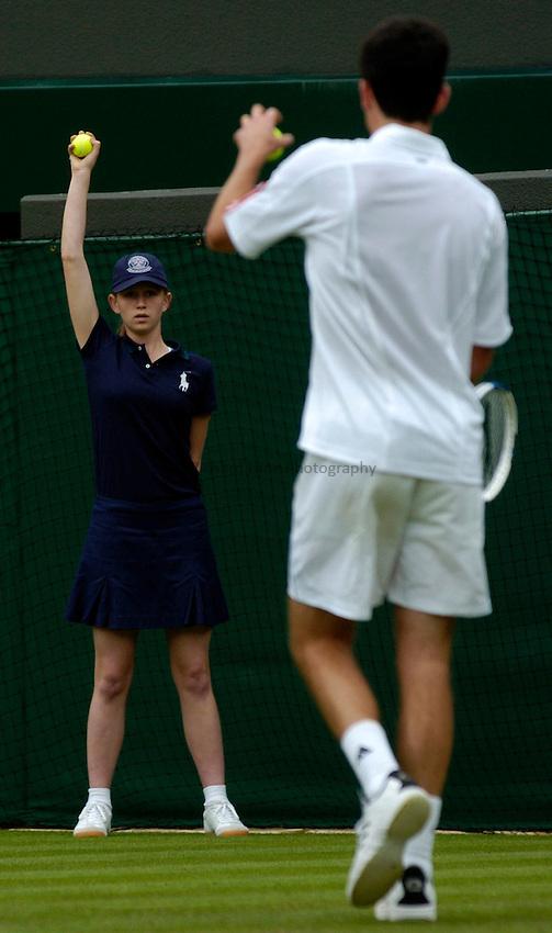 Photo: Richard Lane..Wimbledon Championships. 27/06/2006. .A ball girl throws to Tim Henman