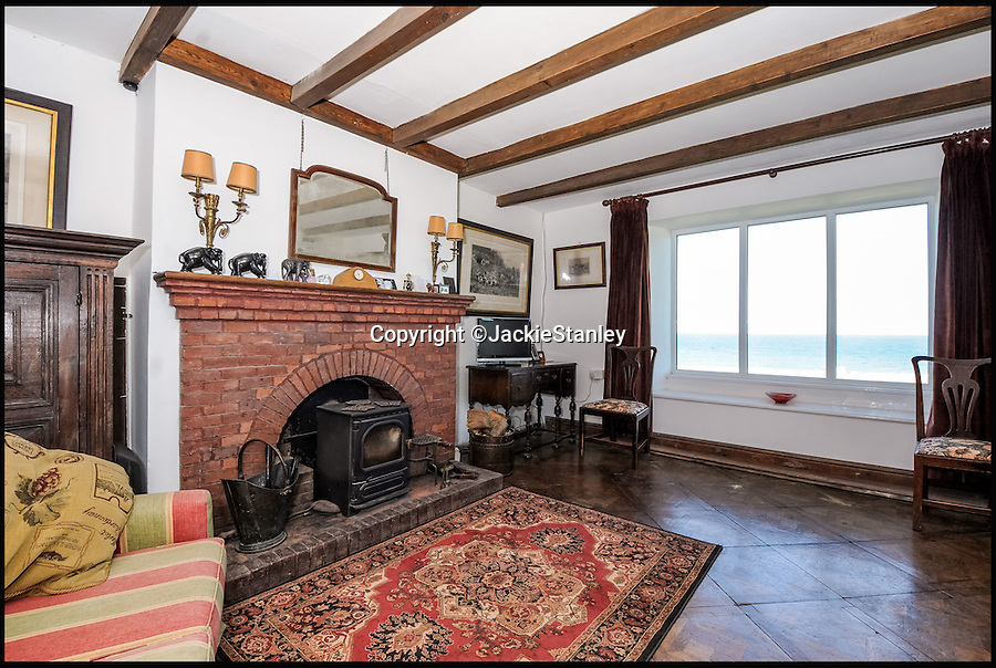 BNPS.co.uk (01202 558833)<br /> Pic: JackieStanley/BNPS<br /> <br /> The best view in England?<br /> <br /> A pretty beach-side house with breathtaking panoramic views that make it seem like you are on the 'edge of the Earth' is on the market for £3million.<br /> <br /> Mother Ivey House is in the highly sought-after area of Trevose Head, part of Cornwall's Area of Outstanding Natural Beauty, and has spectacular uninterrupted views out to sea.<br /> <br /> The former fish sellers' store has been beautifully converted into a family home and is just a stone's throw from one of the area's blissful sandy beaches.