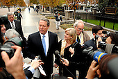 """Washington, DC - November 26, 2007 -- Former United States Vice President Al Gore meets reporters as he and his wife, Tipper walk along Pennsylvania Avenue after his meeting in the Oval Office with United States President George W. Bush on Monday, November 26, 2007.  Gore was at the White House as one of the Nobel Prize honorees who met with the President.  Gore refused to comment or answer any questions calling it a """"private"""" meeting..Credit: Ron Sachs / CNP.[RESTRICTION: No New York Metro or other Newspapers within a 75 mile radius of New York City]"""