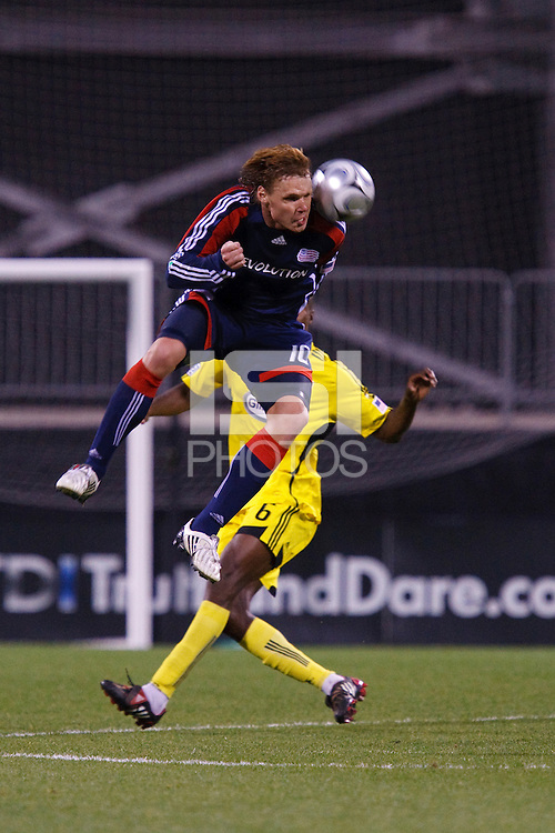 25 OCTOBER 2009:  Edgaras Jankauskas of the New England Revolution (10)   and Andy Iro of the Columbus Crew (7) during the New England Revolution at Columbus Crew MLS game in Columbus, Ohio on October 25, 2009.