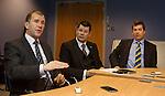 Stewart Regan explains the pyramid league structure as Neil Doncaster listens with David Longmuir