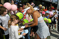 April 11, 2010:  MPS Group Championships.  Caroline Wozniacki (DEN) signs autographs for the fans after winning the finals singles action at the MPS Group Championships played at the Sawgrass Country Club in Ponte Vedra, Florida.  Caroline Wozniacki (DEN) defeated Olga Govortsova (BLR) 6-2, 7-5 to win the tournament for the second consecutive year..