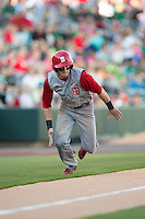 Brock Deatherage (13) of the North Carolina State Wolfpack takes off for home plate against the Charlotte 49ers at BB&T Ballpark on March 31, 2015 in Charlotte, North Carolina.  The Wolfpack defeated the 49ers 10-6.  (Brian Westerholt/Four Seam Images)