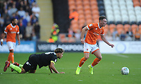Blackpool's Jordan Thompson gets away from Macclesfield Town's Theo Vassell<br /> <br /> Photographer Kevin Barnes/CameraSport<br /> <br /> The Carabao Cup First Round - Blackpool v Macclesfield Town - Tuesday 13th August 2019 - Bloomfield Road - Blackpool<br />  <br /> World Copyright © 2019 CameraSport. All rights reserved. 43 Linden Ave. Countesthorpe. Leicester. England. LE8 5PG - Tel: +44 (0) 116 277 4147 - admin@camerasport.com - www.camerasport.com