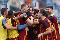 Calcio, Serie A: Lazio vs Roma. Roma, stadio Olimpico, 3 aprile 2016.<br /> Roma's Edin Dzeko, third from left, celebrates with teammates after scoring during the Italian Serie A football match between Lazio and Roma at Rome's Olympic stadium, 3 April 2016.<br /> UPDATE IMAGES PRESS/Riccardo De Luca