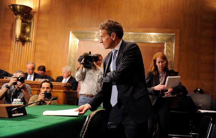 "UNITED STATES - OCTOBER 06:  Treasury Secretary Timothy Geithner prepares to testify before the Senate Banking, Housing and Urban Affairs Committee hearing in Dirksen Building entitled ""Financial Stability Oversight Council Annual Report to Congress.""  (Photo By Tom Williams/Roll Call)"