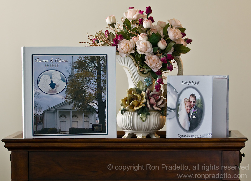"Two different wedding albums,designed, printed and bound by Ron Pradetto Photography. A 12"" and 8"" lay-flat album with a printed canvas cover. Albums are personalized for each couple.  Albums can be made in almost any size up to 12"" and any amount of pages, minimum 20 pages."