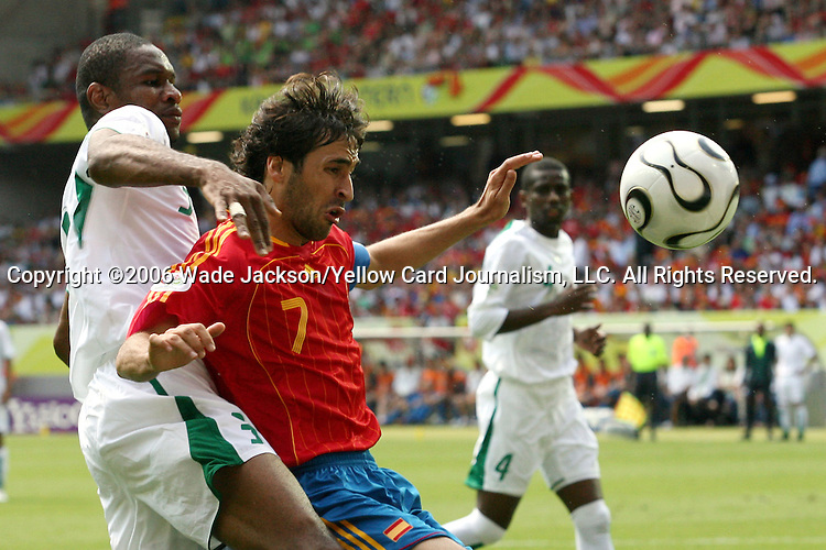 23 June 2006: Raul (ESP) (7) shields Redha Tukar (KSA) (left) away from the ball. Spain defeated Saudi Arabia 1-0 at Fritz-Walter Stadion in Kaiserslautern, Germany in match 47, a Group H first round game, of the 2006 FIFA World Cup. With the win, Spain goes through as the top team in Group H, while Saudi Arabia is eliminated with the loss.
