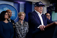 US President Donald J. Trump, with members of the COVID-19 coronavirus task force, responds to a question from the news media during a press conference in the press briefing room at the White House in Washington, DC, USA, 14 March 2020. To date there are 2175 confirmed cases of COVID-19 coronavirus in the US with 50 deaths.<br /> Credit: Shawn Thew / Pool via CNP/AdMedia